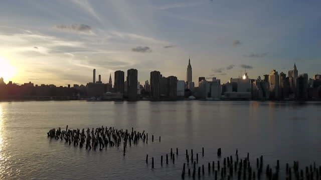 Exterior scenic shots of the Manhattan skyline from across the East River at sunset on April 30 2017 in New York NY