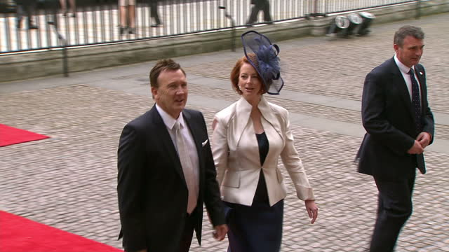 exterior shot australian prime minister julia gillard her husband walk into westminster abbey interior shots julia gillard her husband greet members... - 40 seconds or greater stock videos & royalty-free footage