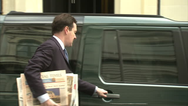 exterior shot chancellor george osborne walks from number 11 downing street into waiting vehicle is driven away george osborne departs 11 downing... - george osborne stock videos & royalty-free footage