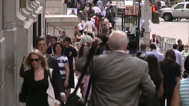 Exterior shot city workers crowds of people walking along Wall Street City Workers Walking on Wall Street on August 07 2012 in New York