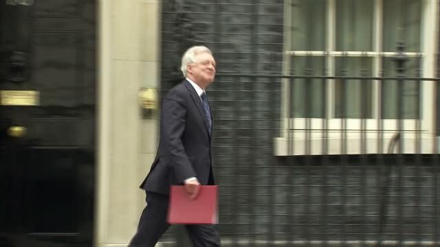 exterior shot david davis mp, brexit secretary walks into 10 downing street in london, england on tuesday 14th march 2017. - david m. davis politician stock videos & royalty-free footage