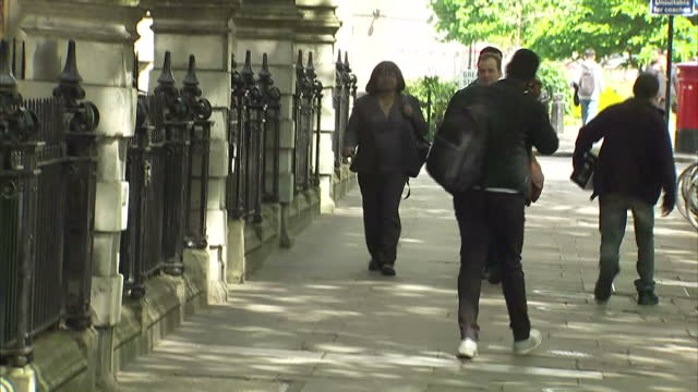 exterior shot diane abbott shadow home secretary walks along towards millbank in london england on tuesday 2nd may 2017 - diane abbott stock videos & royalty-free footage