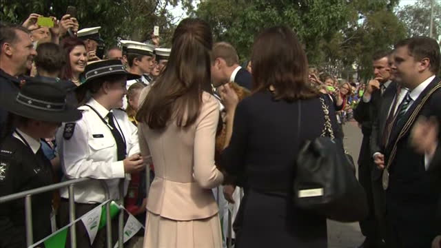 exterior shot Duke and Duchess of Cambridge speaking to supporters in crowd waiting behind barrier