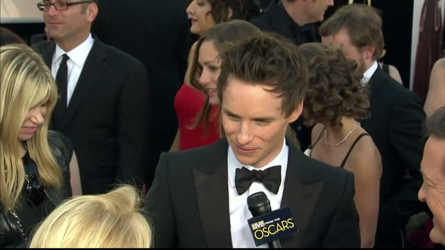 Exterior shot Eddie Redmayne chats to the press on the red carpet Eddie Redmayne on the Red Carpet at Dolby Theatre on February 25 2013 in Hollywood...
