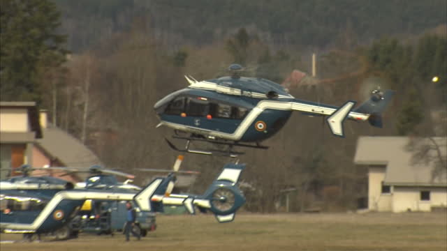 exterior shot gendarmerie, police helicopter landing near to the site where a germanwings airbus a320 crashed. on march 25, 2015 in seyne, france. - polizeirevier stock-videos und b-roll-filmmaterial