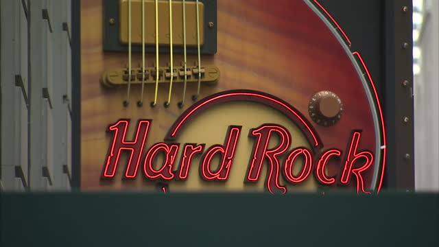 exterior shot hard rock cafe spinning guitar signage outside times square restaurant on 01st june 2012 in new york usa - hard rock cafe stock videos & royalty-free footage