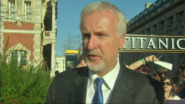 stockvideo's en b-roll-footage met exterior shot james cameron talks on the red carpet at the titanic 3d premier on the lasting fascination with the titanic his 3d film james cameron... - titanic