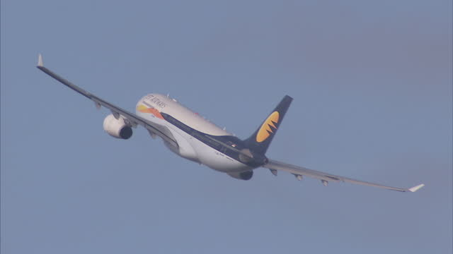 exterior shot jet airways passenger plane turning in sky shortly after take off on march 05 2010 in brussels belgium - flugpassagier stock-videos und b-roll-filmmaterial
