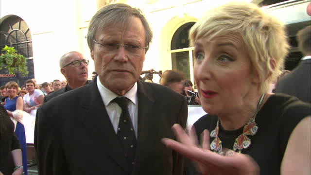 exterior shot julie hesmondhalgh and david neilson on red carpet talking about their controversial storyline in coronation street on may 18 2014 in... - コロネーションストリート点の映像素材/bロール