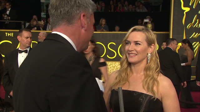 exterior shot kate winslet, actress on academy awards red carpet talking about it being leonardo dicaprio's year and he should win academy award for... - kate winslet stock videos & royalty-free footage