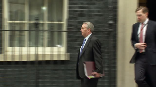 exterior shot liam fox mp secretary of state for international trade departing downing street exit in london england on tuesday 14th march 2017 - liam fox politician stock videos and b-roll footage