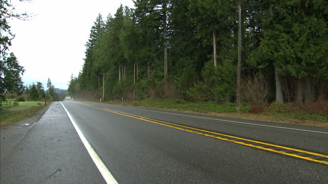 exterior shot lorry driving down road in rural washington state on 27th march 2014 in oso washington state united states - oso washington stock videos & royalty-free footage