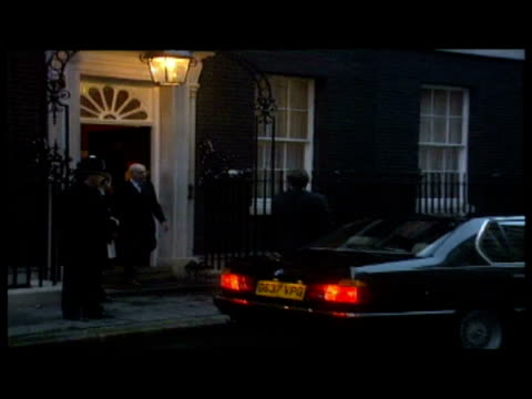 exterior shot mark thatcher leaving number 10 downing street night shot denis thatcher leaves number 10 and gets into car exterior shot mark thatcher... - 辞職点の映像素材/bロール