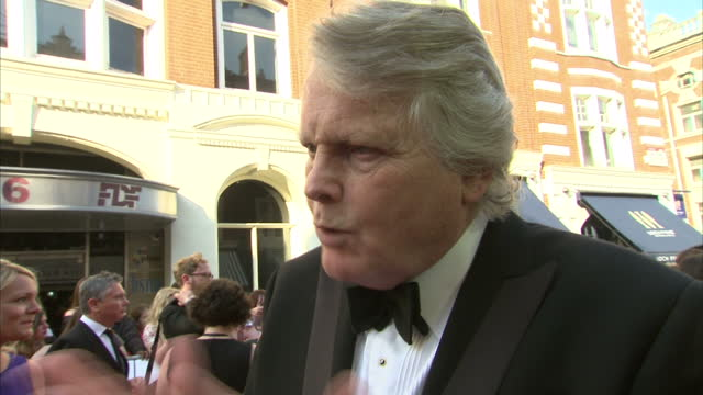 stockvideo's en b-roll-footage met exterior shot michael dobbs author on red carpet talking about how making a tv series for netflix differs to a standard weekly show on may 18 2014 in... - michael dobbs