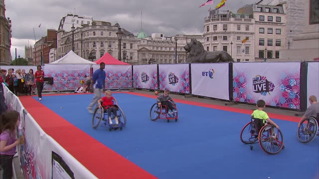 exterior shot national gallery in trafalgar square with the paralympic logo hanging its facade exterior shots children in wheelchairs engage in ball... - nelson's column stock videos & royalty-free footage