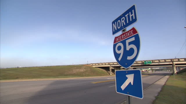 Exterior shot 'North Interstate 95' road sign with vehicles passing in background on 19th October 2012 in Dillon South Carolina USA