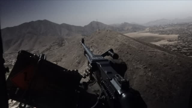 exterior shot of a military helicopter side machine gun while the helicopter is in flight over kabul on 30th august 2018 in afganistan - machine gun stock videos & royalty-free footage