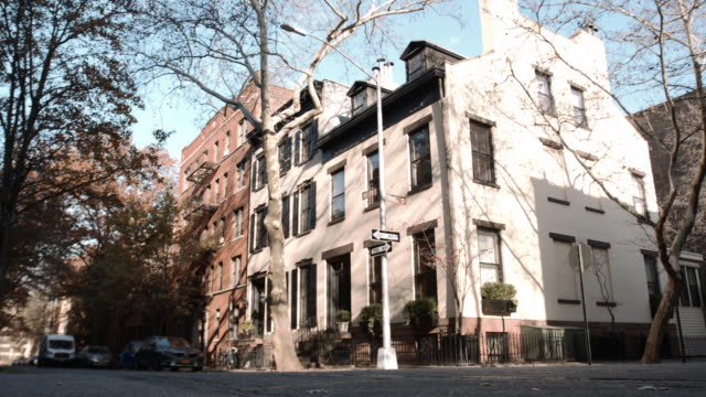 exterior shot of an unrecognizable building in brooklyn. - neighborhood street sign stock videos and b-roll footage