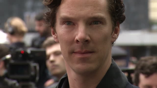 exterior shot of benedict cumberbatch posing for paparazzi at the premiere of the dark knight rises in leicester square. the dark knight rises... - benedict cumberbatch stock videos & royalty-free footage