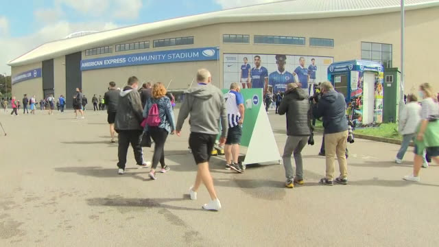 exterior shot of brighton & hove albion football club supporters arriving at the amex stadium for a match against chelsea and shots of people using... - spectator stock videos & royalty-free footage