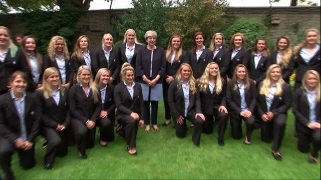 exterior shot of british prime minister theresa may meeting england women's cricket team during reception at no10 downing street and posing for photo... - cricket team stock videos and b-roll footage