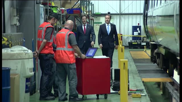 exterior shot of david cameron nick clegg arriving at rail engineering works in the west midlands david cameron nick clegg meet rail engineers on... - engineering stock videos & royalty-free footage