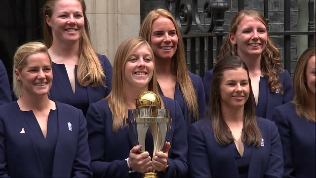 exterior shot of england women's cricket team posing for photo opportunity with world cup trophy outside no 10 downing street on 29th august 2017... - cricket team stock videos and b-roll footage