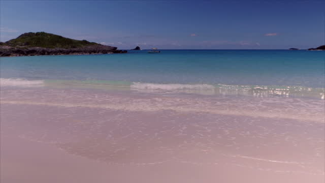 exterior shot of gentle sea waves lapping up onto whiite sandy beach on july 20 2016 in bermuda - bermuda stock videos & royalty-free footage