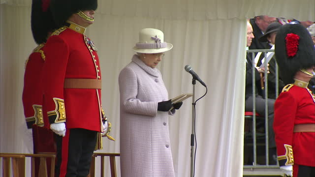 exterior shot of hm queen elizabeth ii making speech to coldstream guards regiment on presentation of new colours thirteen years have passed since i... - the queen's speech state opening of uk parliament stock-videos und b-roll-filmmaterial