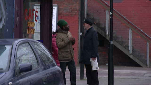 exterior shot of jeremy corbyn leader of the labour party walking through islington in his constituency wearing a black flat cap hat talks to local... - flat cap stock videos & royalty-free footage
