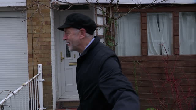 exterior shot of jeremy corbyn leader of the labour party walking home after going out to buy a newspaper wearing black flat cap hat politely and... - flat cap stock videos & royalty-free footage