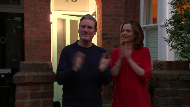 exterior shot of sir keir starmer with his wife victoria starmer in front of their house clapping for carers on 9 april 2020 in london, united kingdom - keir starmer stock videos & royalty-free footage
