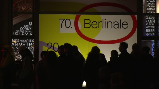 exterior shot of the friedrichstadtpalast cinema goers wait in front of the admission a berlinale poster can be seen in the background during the... - festival poster stock videos & royalty-free footage