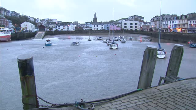 exterior shot of the harbour with anchored boats on january 3, 2014 in ifracombe, north devon, england. - anchored stock-videos und b-roll-filmmaterial