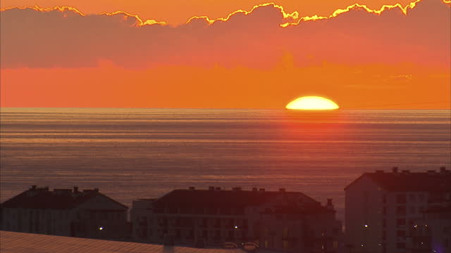 Exterior shot of the sun setting over the Black Sea in Sochi>> on February 05 2014 in Sochi Russia