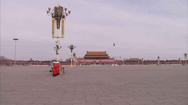stockvideo's en b-roll-footage met exterior shot of the tiananmen square parade ground as a police van drives past on the opening day of the national people's congress on may 3rd 2010... - van
