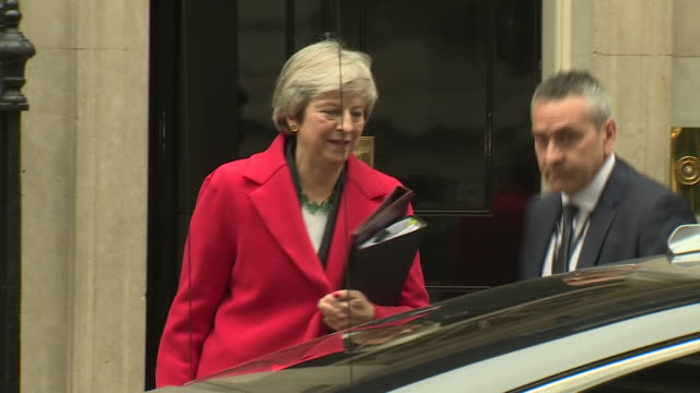 Exterior shot of Theresa May departing No 10 Downing Street to travel to The Houses of Commons on 15 November 2018 in London United Kingdom