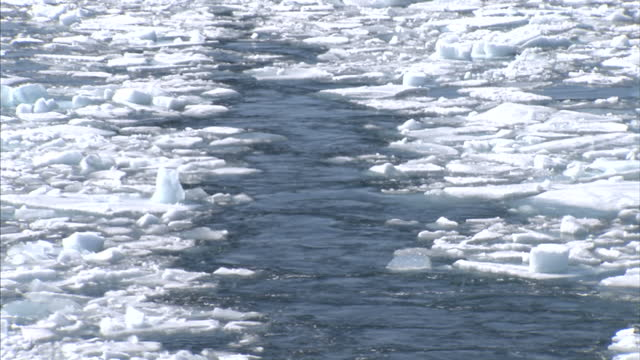 exterior shot of trail of broken ice left in the wake of an icebreaker. on august 25, 2007 in cambridge bay, canada. - icecap stock videos & royalty-free footage