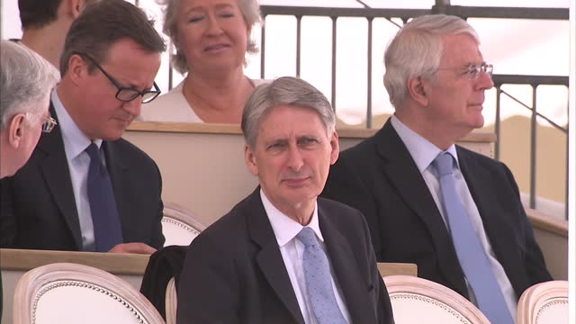 exterior shot philip hammond, chancellor sat smiling and chatting, pan out talking to michael fallon, defence secretary , former prime ministers john... - war memorial stock videos & royalty-free footage