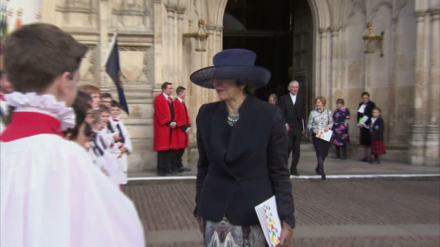 exterior shot prime minister theresa may meet and greet young boys from church choir walks quite quickly looking slightly awkward smiling at... - queen royal person stock videos & royalty-free footage