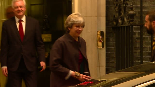 Exterior shot Prime Minister Theresa May walks out from No 10 Downing Street followed by David Davis Brexit Secretary and gets into waiting car which...