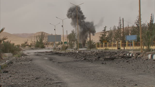 Exterior shot Russian military carrying out controlled explosion of IED bomb left at side of the road by Islamic State militants before they were...
