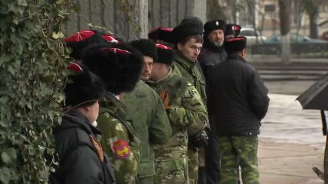 Exterior shot Russian soldiers in Cossack hats standing guard outside government building in Simferopol Crimea on March 07 2014 in Simferopol Ukraine