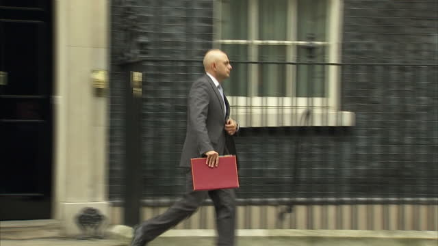 exterior shot sajid javid mp communities and local government secretary departs 10 downing street in london england on tuesday 14th march 2017 - sajid javid stock videos & royalty-free footage