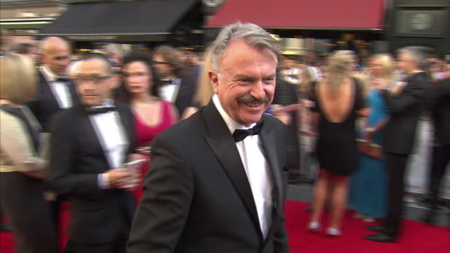 Exterior shot Sam Neill actor signing autographs on BAFTA red carpet on May 18 2014 in London England