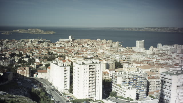 vidéos et rushes de exterior shot. sweeping view of the if-castle and frioul islands and surrounding city. travel destination - marseille