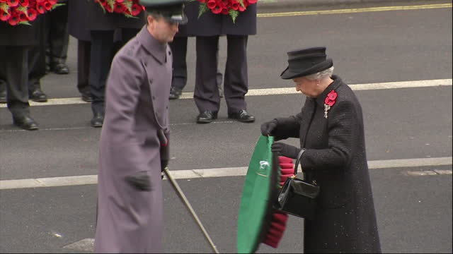 exterior shot the queen walks up to the cenotaph monument & lays wreath before stepping back & bowing her head. the queen lays wreath at the cenotaph... - bowing stock videos & royalty-free footage