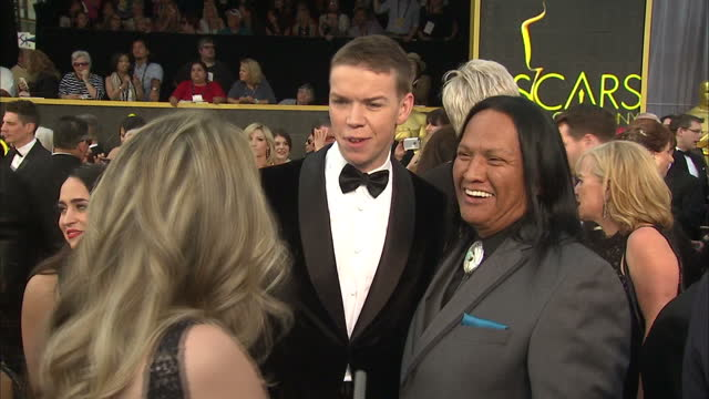 Exterior shot Will Poulter and Arthur RedCloud on Academy Awards red carpet talking about working with director Alejandro Inarritu on the film 'The...