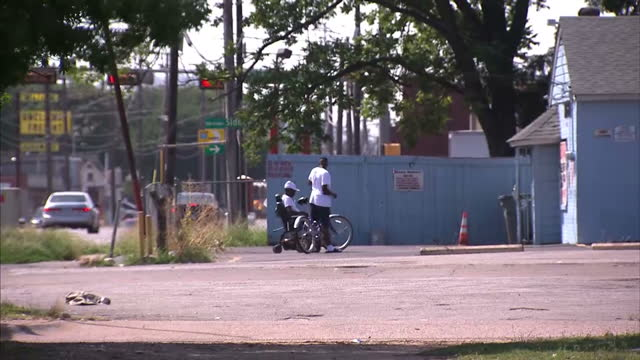 exterior shot young african american men socialising at side of the road in dixon circle neighbourhood on july 10 2016 in dallas texas - recession stock videos & royalty-free footage
