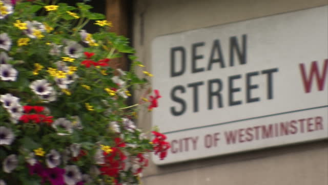 exterior shots 56 dean street sexual health clinic buildings and signage on september 02, 2015 in london, england. - レトロウィルス点の映像素材/bロール